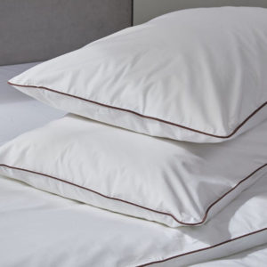 Piping edged luxurious white percale organic cotton pillowcases