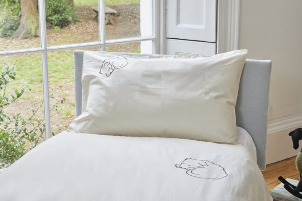 Snoozy dog embroidered single organic duvet set